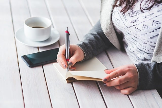 woman-writing-on-a-notebook
